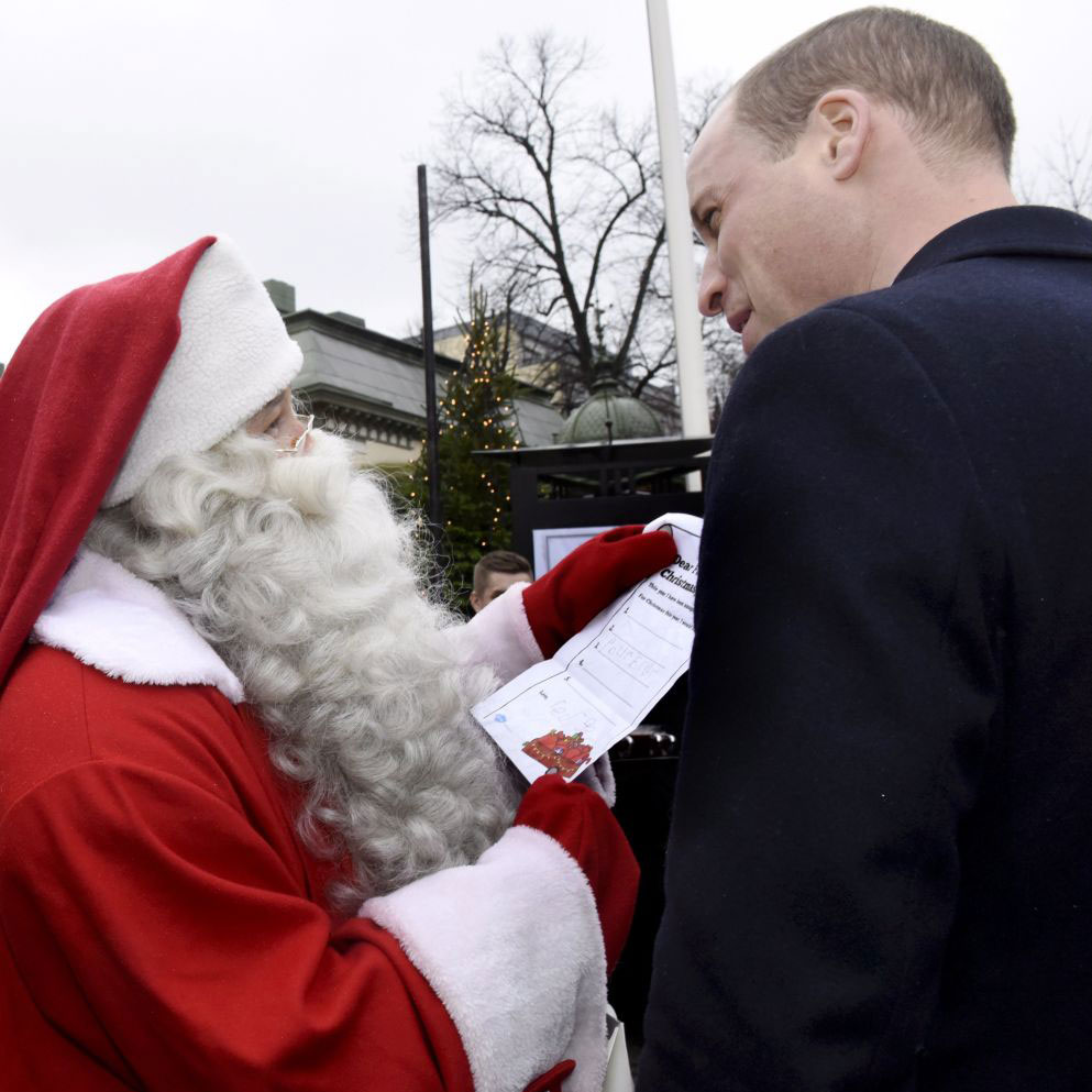 Prince William hand delivers son Prince George's Christmas present wish-list to Santa Claus – and the future king