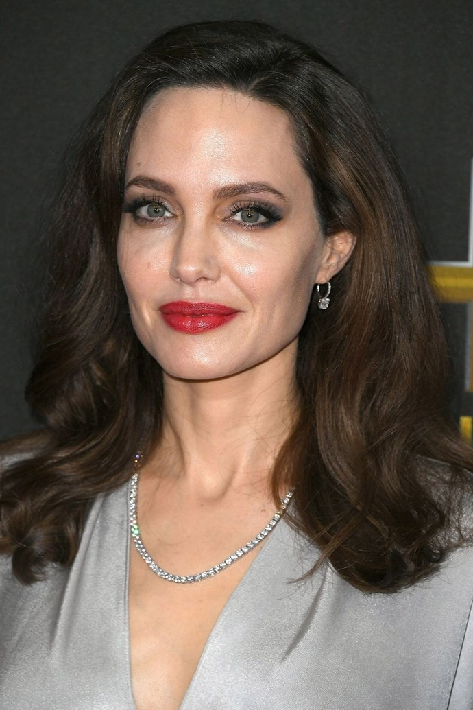 """**3. Angelina Jolie** <br><br> """"Angelina's cheeks have a natural plumpness that accentuates her youthful appearance."""""""