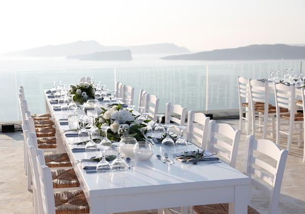 **On the reception: **   Our reception was an outdoor sit-down dinner on our private villa rooftop overlooking the caldera and the breathtaking Santorini sunset. It was buffet style, which gave our guests the flexibility to choose what and as much as they wanted.