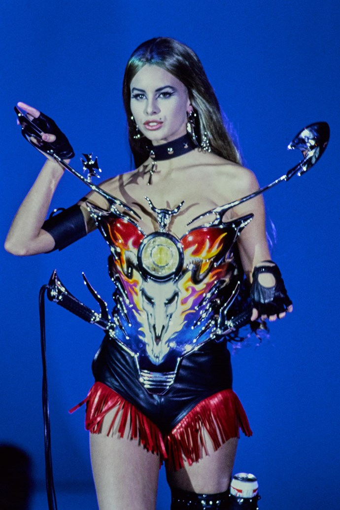 **THIERRY MUGLER SPRING 1992** <br><br> Thierry Mugler is known for his over-the-top approach to fashion, but it was his spring 1992 show that caught everyone off-guard. The collection proved to be more about contraptions than clothing, whereby his creations were designed using sharp edges, leather and embellishment. The edgy collection also featured a bodice that was made to look like a motorcycle, which included side mirrors and handles.