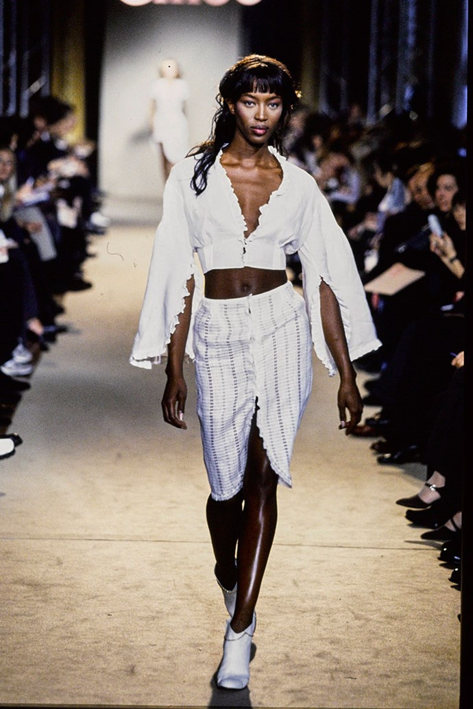 """**CHLOÉ SPRING SUMMER 1998** <br><br> This show was Stella McCartney's first for the French fashion house. The designer made headlines for hiring her supermodel friends Kate Moss and Naomi Campbell, and for having her musician father, Sir Paul McCartney, in the front row. <br><br> This come just three years after she hired the two supermodels for her Central St Martins degree show, a move she now regrets. """"I look back on that moment and just feel a bit embarrassed that I was so naïve,"""" McCartney said in an interview with the *BBC*."""