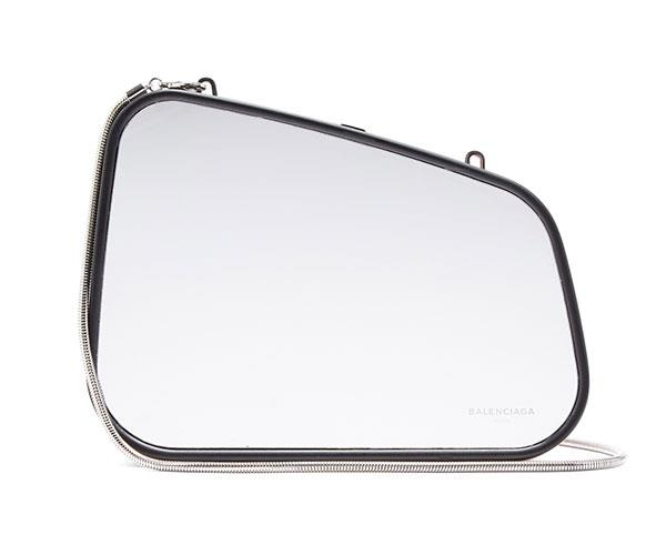 "**Balenciaga Case Retroviseur Clutch** <br><br> $2,925, available at [MATCHESFASHION.COM](https://www.matchesfashion.com/products/Balenciaga-Case-Retroviseur-clutch-1170550|target=""_blank"")."