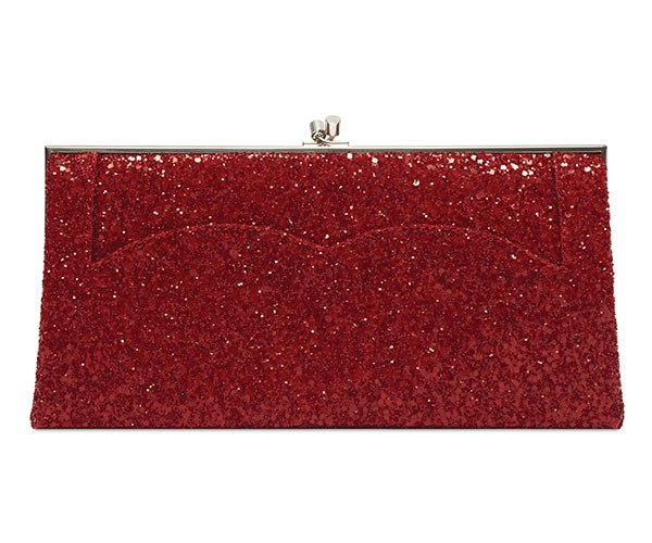 "**Victoria Beckham Pocket Clutch** <br><br> Approx. $1,700, available at [Victoria Beckham](https://www.victoriabeckham.com/accessories/christmas-vba-170-glitter-red-os.html|target=""_blank"")."