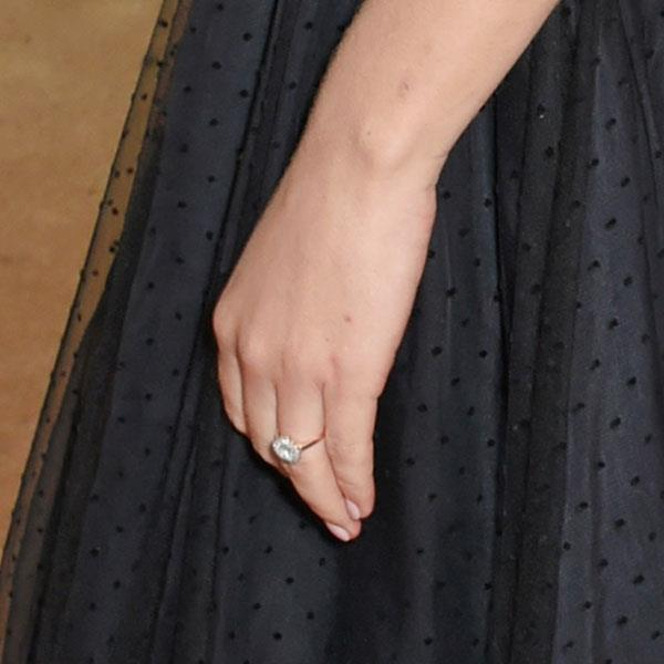 **Felicity Jones** <br><br> Felicity Jones got engaged to director Charles Guard in May, however, didn't debut her ring until a month later at *Glamour's* Women of the Year Awards in London. The large round-cut diamond sits on top of a thin gold band.