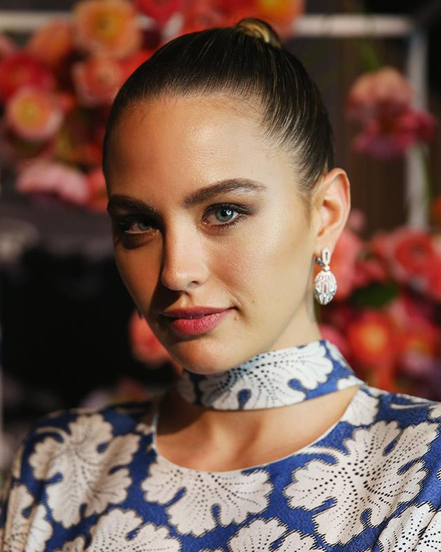 **The slicked-back bun** <br><br> Franklin scraped back all of her hair for a *BAZAAR in Bloom* event.