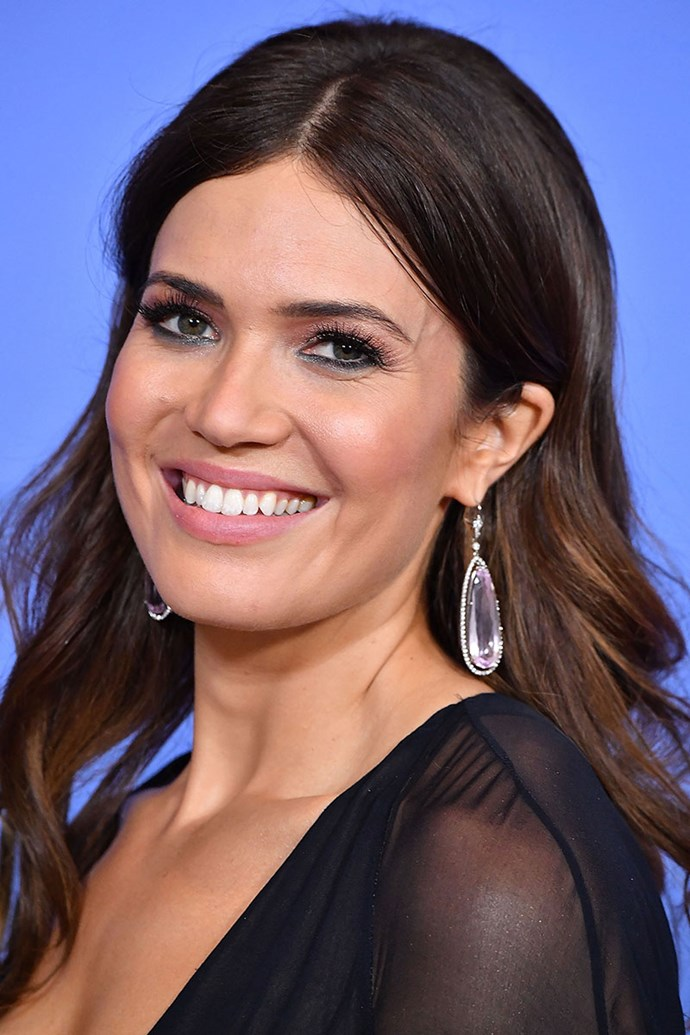 **MANDY MOORE** <br><br> Mandy opted for a simple makeup look which was complemented with sparkly eyeshadow and a statement lower lash line in 2017.