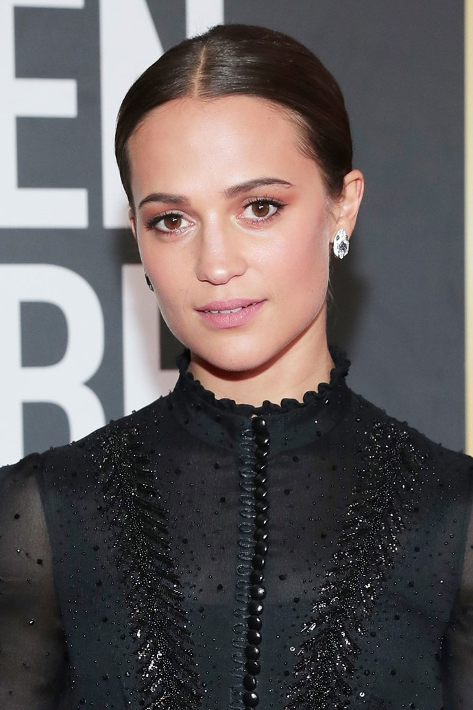 **Alicia Vikander** <br><br> The *Tomb Raider* actress' beauty look heavily featured in blush tones, which were paired with a slicked back 'do.