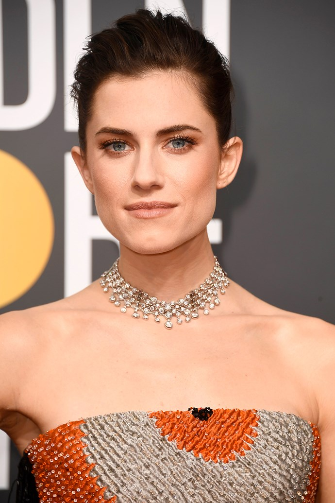 **Allison Williams** <br><br> We absolutely love Alison Williams' copper toned eyes and coiffed updo.