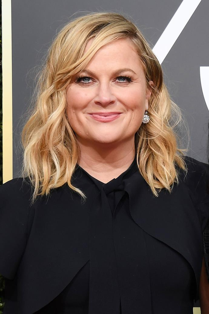 **Amy Poehler** <br><br> Comedian Amy Poehler brought beach waves to this year's Golden Globes red carpet, pairing them with a bronze eye and a nude lip.