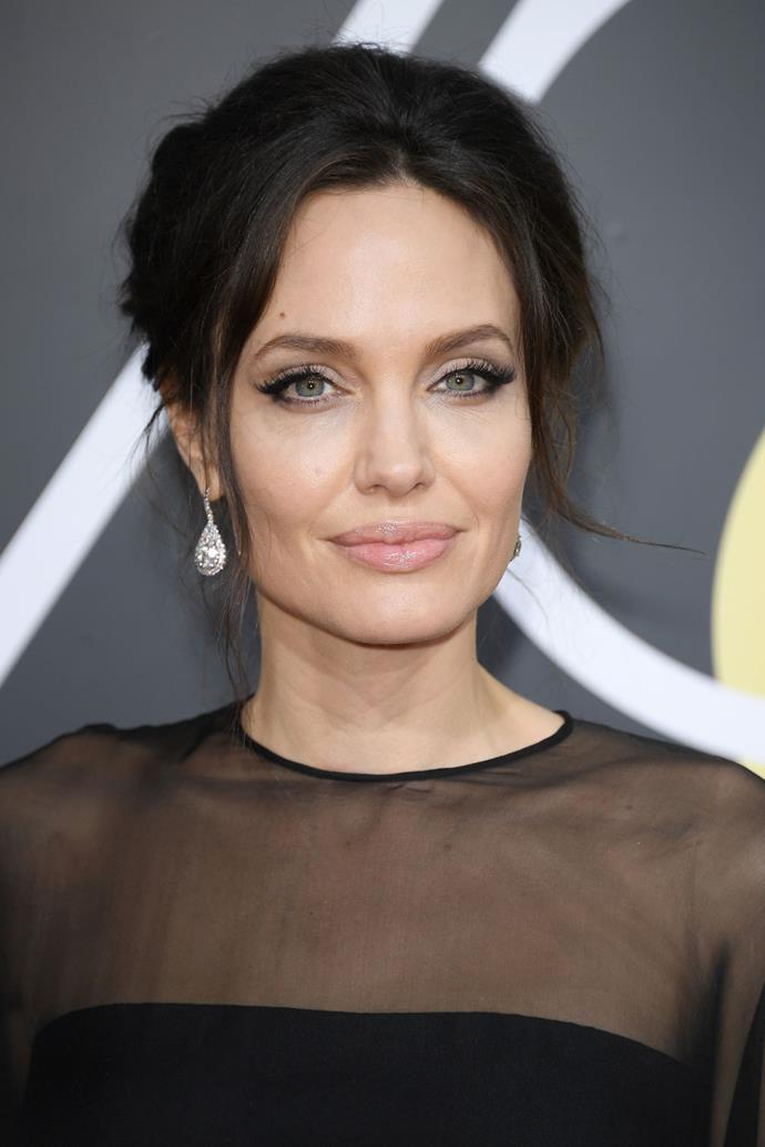 **Angelina Jolie** <br><br> Jolie opted for a retro hairstyle and a winged eye.