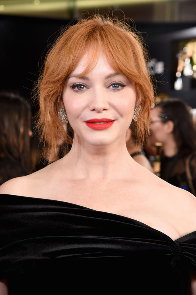 **Christina Hendricks** <br><br> Fellow redhead Christina Hendricks also wore another beauty look fit for those with warm-toned hair: A bright-red lip