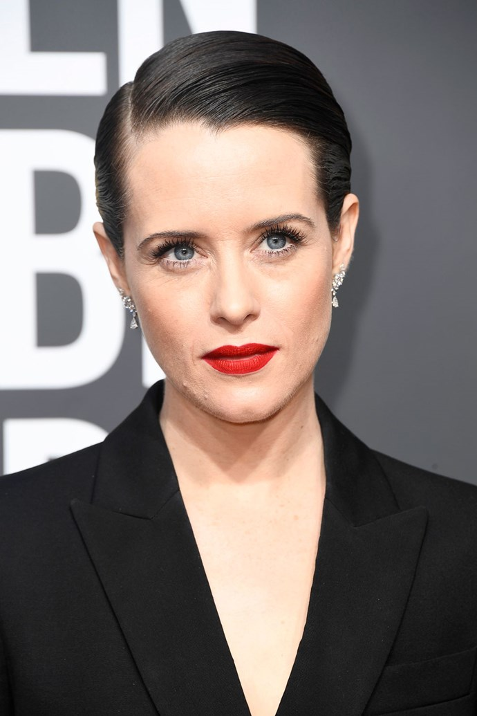 **Claire Foye** <br><br> *The Crown* actress looks every bit as elegant as the queen she plays. Foye gives us regal beauty with a red lip and a sleek, yet voluminous hair style.