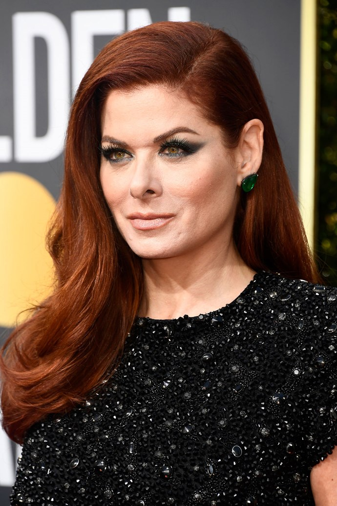 **Debra Messing** <br><br> The *Will & Grace* actress knows all too well that the best thing to pair with fiery red tresses is a pop of emerald green liner.