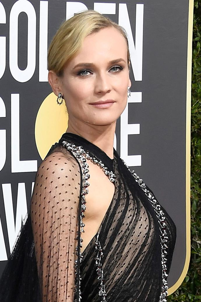 **Diane Kruger** <br><br> Also a fan of the tousled updo, Diane Kruger paired the hairstyle with a cool-toned smokey lid.