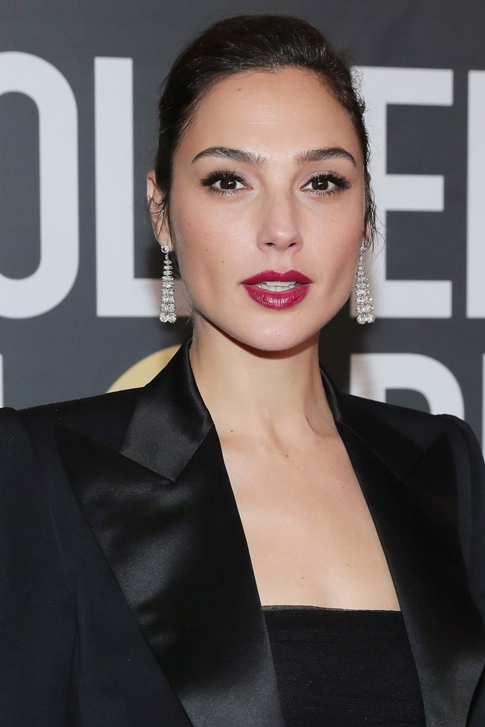 **Gal Gadot** <br><br> The *Wonder Woman* actress kept an almost entirely pulled-back beauty look, with a berry lip as a pop of colour.