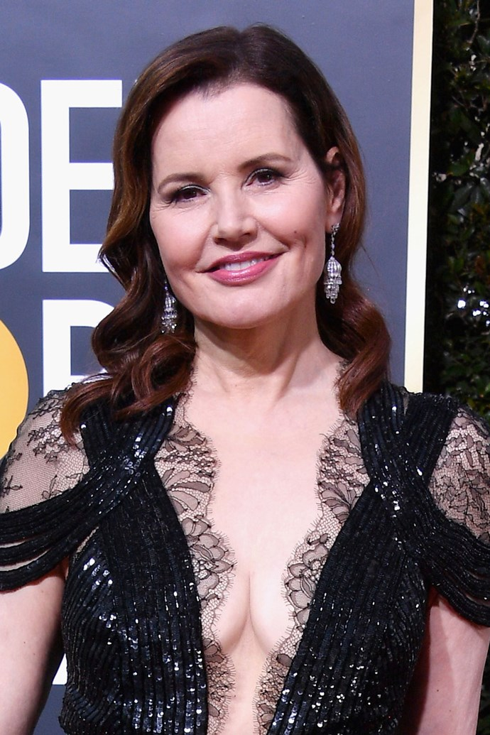 **Geena Davis** <br><br> David keeps her red carpet beauty look simple with a wavy lob and shiny pink lip.