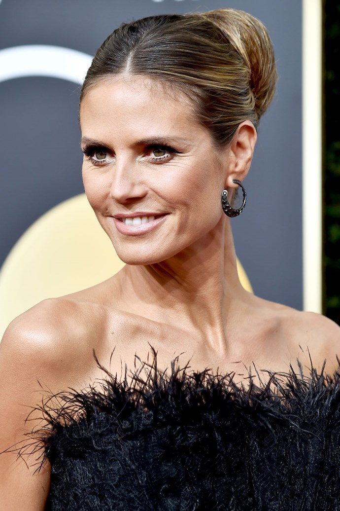 **Heidi Klum** <br><br> Klum rocked an ultra-gram chignon bun on this year's red carpet, but the supermodel pulled back her look with minimal makeup.