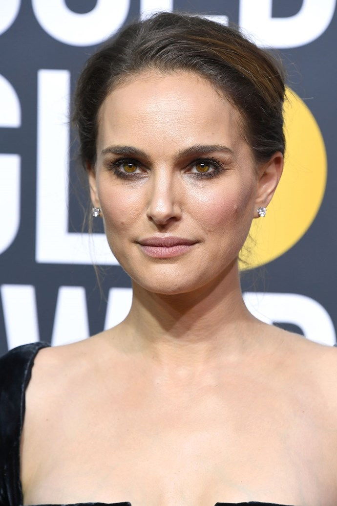 **Natalie Portman** <br><br> No one rocks a smudged black eyeliner quite like Natalie Portman. She finishes her look with a nude lip and hair loosely pulled back.