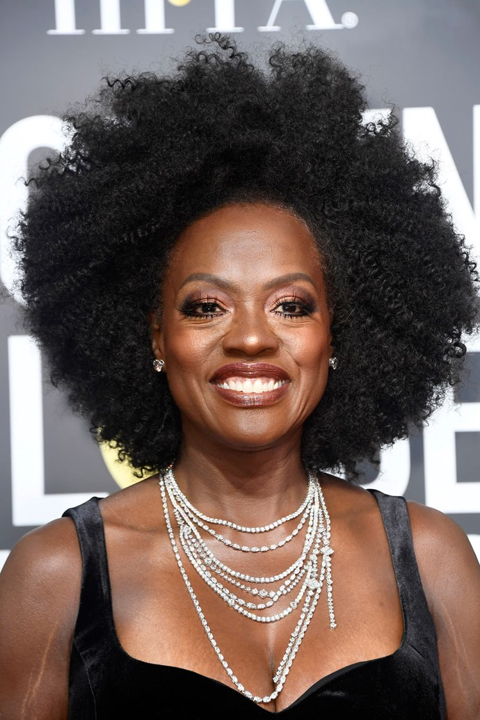 **Viola Davis** <br><br> Viola's red carpet beauty look was all about bronze-toned makeup and her amazing natural curls.