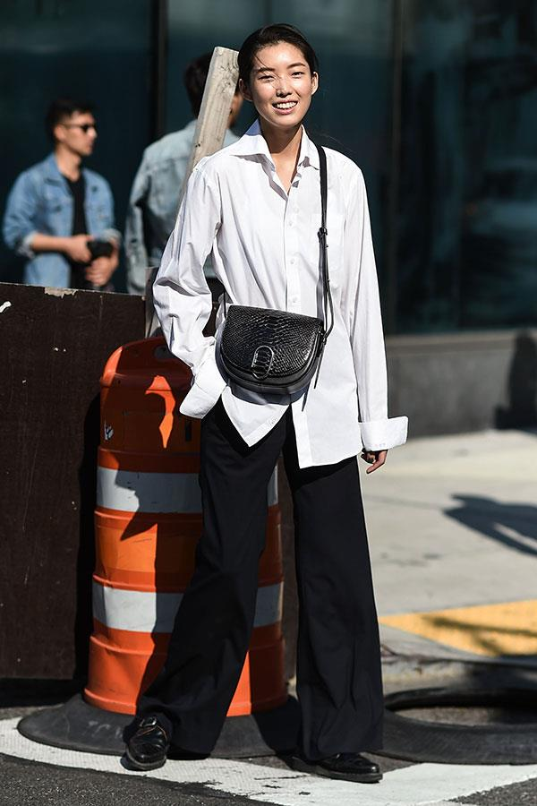 **A Crisp White Shirt, Cross-Body Bag And Wide-Leg Trousers:** The sharp finish of this outfit makes it perfect for impromptu coffee meetings, while the loose fit makes it a winner in unpredictable weather.
