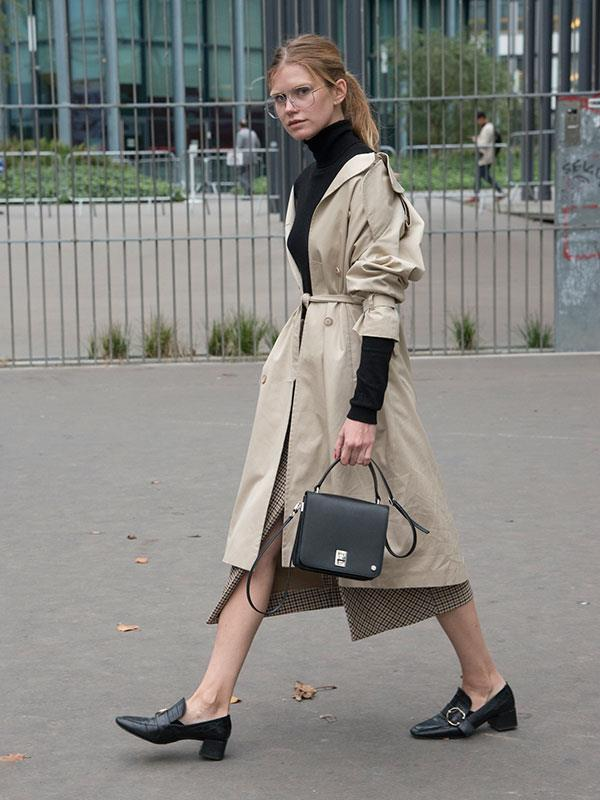 **A Trench Coat, Turtleneck And Mules:** Practical and stylish, the belted trench is the perfect way to inject a little 'fashion' into librarian-chic ensembles. Glasses optional.