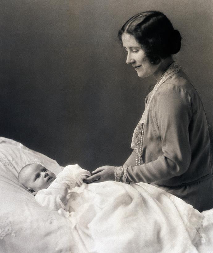 Elizabeth, Duchess of York, with an infant Princess Margaret Rose.