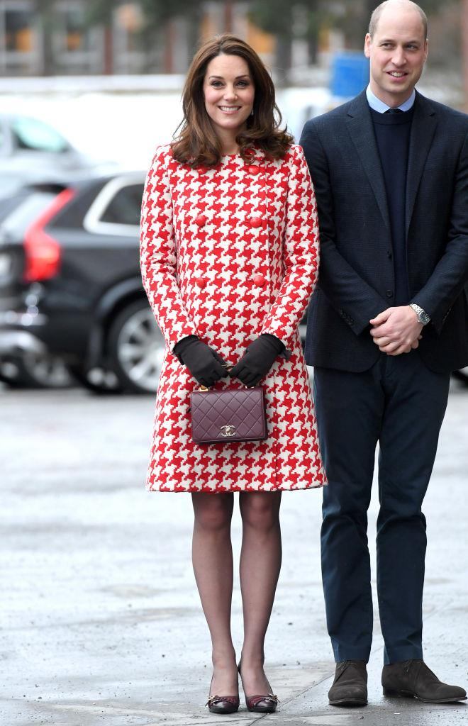January 31, 2018 - In Catherine Walker houndstooth coat and Chanel lady bag, while attending an event during her tour of Sweden, when Kate is pregnant with her third child.