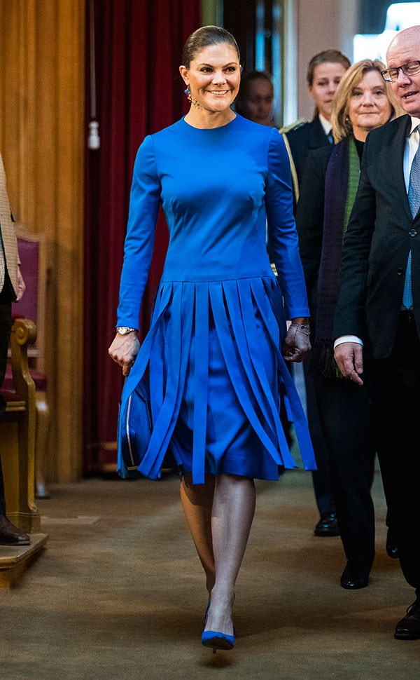 Wearing an electric blue midi skirt with fringe detailing and a Stella McCartney clutch for a seminar in Riksdag on October 18, 2017.