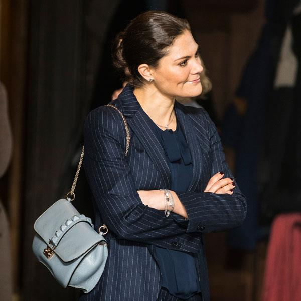 Wearing a pinstripe navy blazer and Valentino bag at 'The Global Ocean and Future of Humanity' Seminar in Stockholm on November 28, 2017.