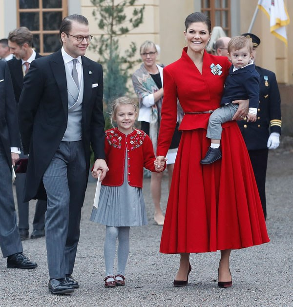 Wearing tailored scarlet coordinates at the christening of Prince Gabriel of Sweden in Stockholm on December 1, 2017.