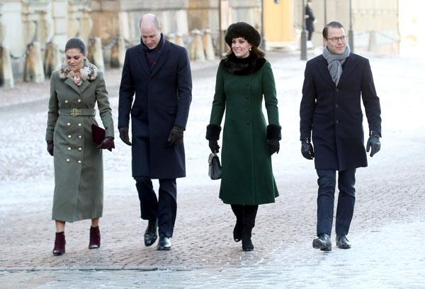 Wearing a khaki coloured overcoat with a faux fur trim by Swedish designer, Ida Sjostedt with husband, Prince Daniel, Kate Middleton and Prince William in Stockholm on January 30, 2018.