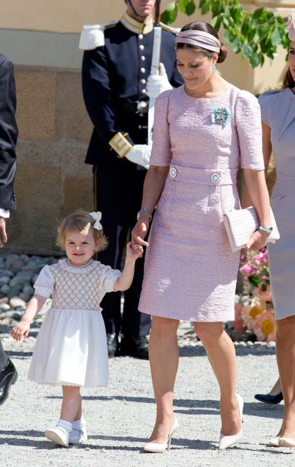 Wearing a blush jacquard Dolce & Gabbana dress and matching Bottega Veneta cluth for Princess Leonore of Sweden's Christening in Stockholm on June 8, 2016.