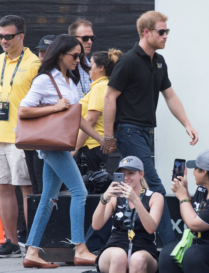 **2017**<br><br>  In a Misha Nonoo shirt, Mother jeans and an Everlane tote with Prince Harry at the 2017 Invictus Games.