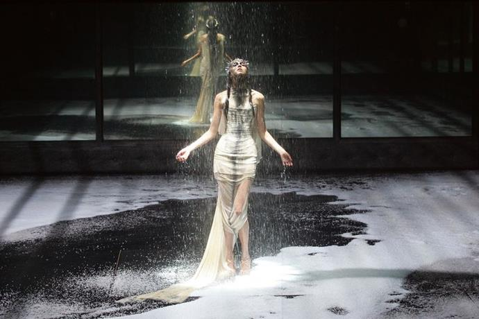 Models are drenched in rain at the 2004 McQueen show