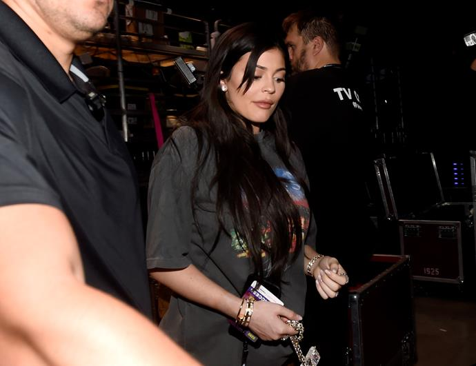 Kylie Jenner kept her bump hidden during her rare public outings with oversized t-shirts.