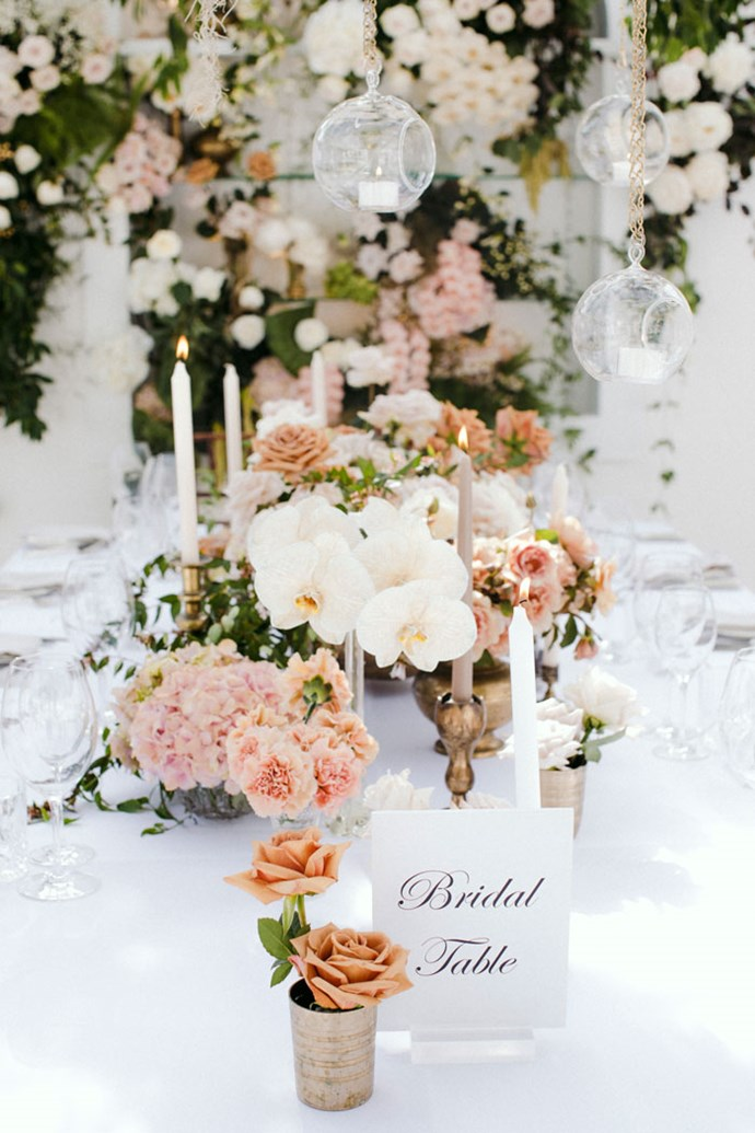 **On the flowers: **I love roses so they were the main flower throughout the wedding. I wanted the florals to be reminiscent of an English garden. We had a mix of very open roses in white, pastel pink, cream and peach, as well as hydrangeas, orchids and peonies.