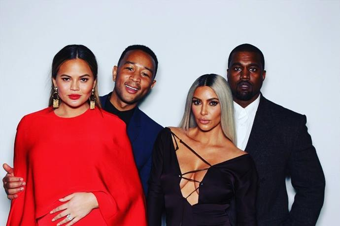Chrissy Teigen, John Legend, Kim Kardashian and Kanye West pose in the photobooth.