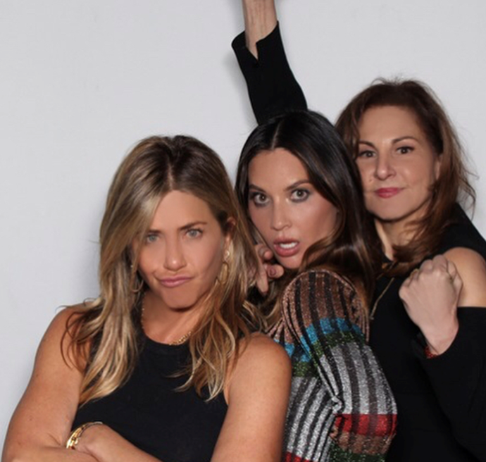 Jennifer Aniston and Olivia Munn get silly in the photo booth at Ellen's 60th.