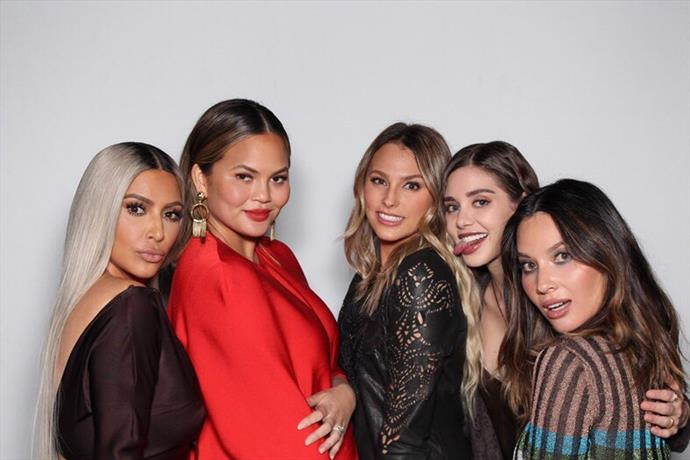 Kim Kardashian, Chrissy Teigen and Olivia Munn take a shot in the photo booth.