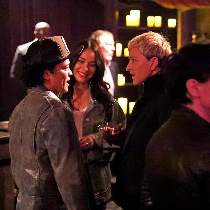 "Ellen chats with Bruno Mars at her birthday party. She shared this photo, captioning it, ""@BrunoMars, I love you."""