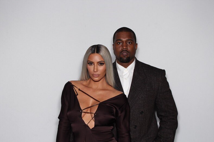 Kim Kardashian and Kanye West at Ellen Degeneres' 60th birthday party.