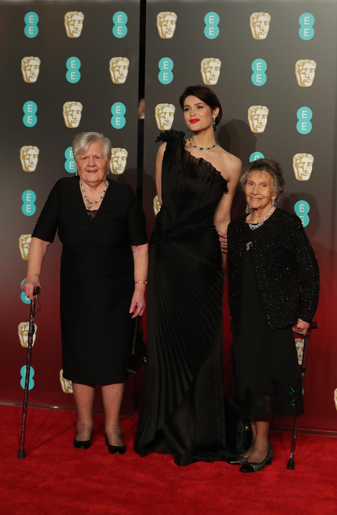Gemma Arterton, in Alberta Ferretti Couture, with Eileen Pullen (R) and Sheila Douglass (L) - both are former Ford Dagenham sewing machinists.