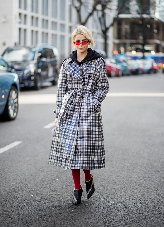 10. Tartan trenches<br><br> Call it Christopher Bailey Fever. Modern iterations of the Burberry tartan trench were spotted everywhere during London Fashion Week. Perhaps no surprise, as Bailey presented his final collection for the brand this season.<br><br>  Caroline Daur<br><br> Image: Getty