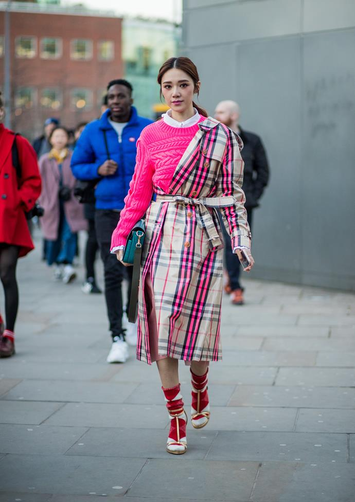 10. Tartan trenches<br><br> Call it Christopher Bailey Fever. Modern iterations of the Burberry tartan trench were spotted everywhere during London Fashion Week. Perhaps no surprise, as Bailey presented his final collection for the brand this season.<br><br> Image: Getty