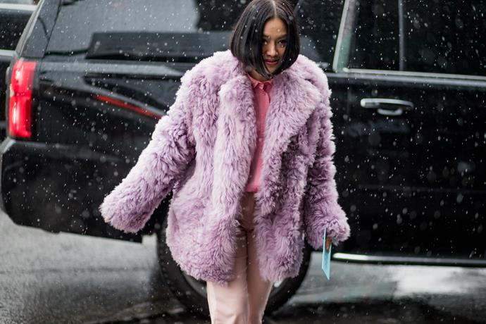 9. Pink fluffy coats<Br><br> Fashion is officially embracing colour again. Case in point? The abundance of bubblegum pink faux fur jackets spotted at the shows. <br><br> Pictured: Tiffany Tsu Image: Getty