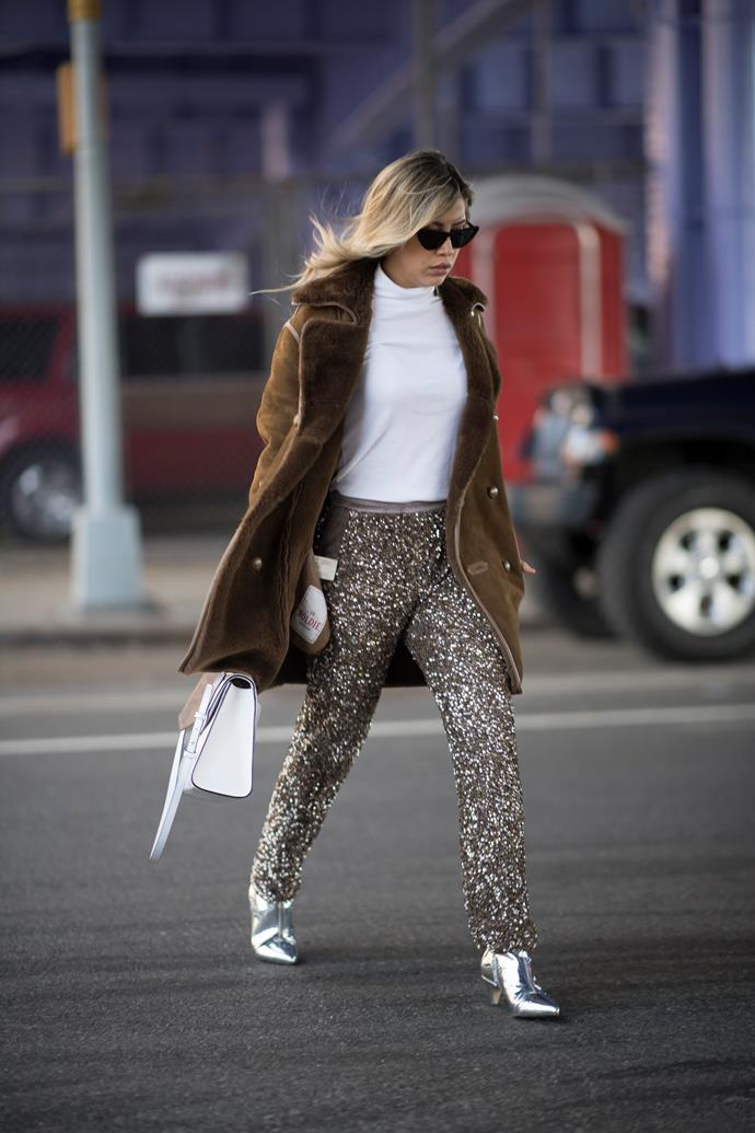 8. Glitterbomb<br><br> Sequins and glitter are no longer the domain of drag queens and Cher. In fact, they become infinitely wearable when tackled in moderation, and paired with netural basics like oversized knits and tailored outerwear. <br><br> Image: Getty