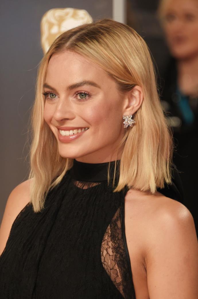 **Margot Robbie** <br> The blunt cut and center part keep Margot Robbie's wavy lob looking sleek, not sloppy.