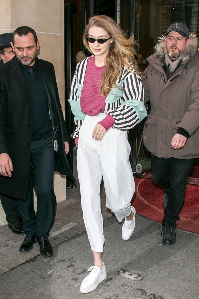 Gigi Hadid stepped out at Paris Fashion Week in an '80s shell suit style jumper that wouldn't look out of place on the set of *Pretty In Pink*.