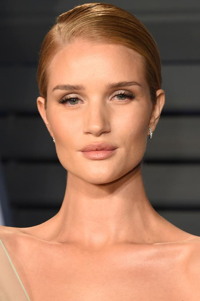 """**Rosie Huntington Whiteley** <br><br> According to [*People*](http://people.com/style/style-celebs-beauty-routines-the-products-they-really-use/rosie-huntington-whiteley/ target=""""_blank"""" rel=""""nofollow""""), the model keeps her lips smooth and free of chapping in a hyper-dry environment, such as a plane, with this travel-friendly cult lip balm."""
