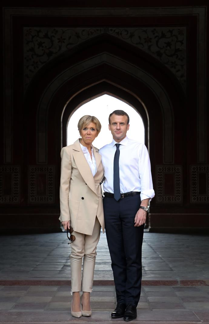 In a tan-coloured suit with husband Emmanuel Macron while visiting India.